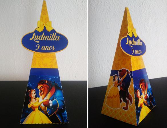 Caixa pirâmide Bela e a Fera-Caixa pirâmide Bela e a Fera com aplique. Fazemos em qualquer tema. Envie nome e idade para perso